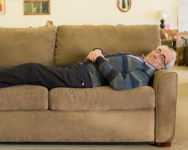 Carlos relaxing on American Leather Comfort Sleeper