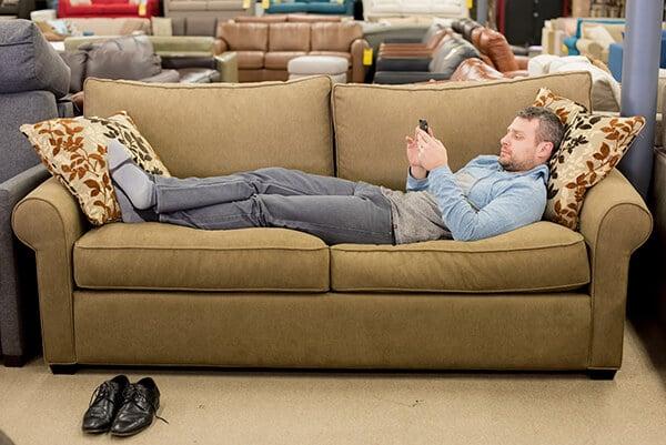David relaxes on Stanton sofa