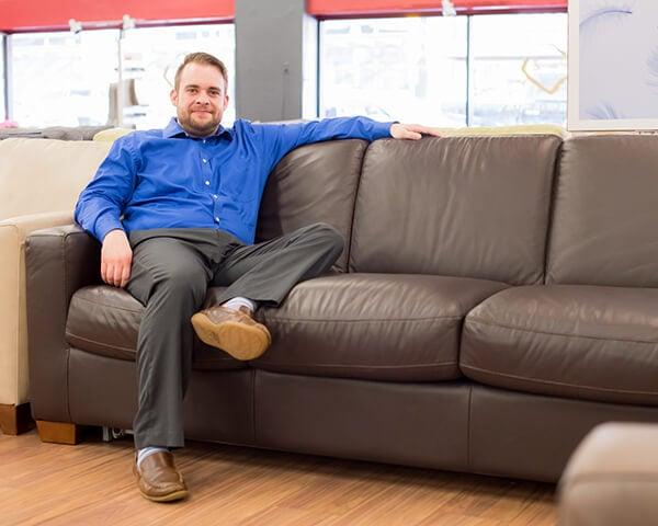 Jake relaxes on Natuzzi leather sleeper sofa