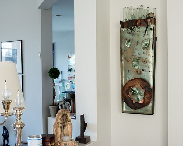 Curating and Displaying Art: Glass Face on Wall